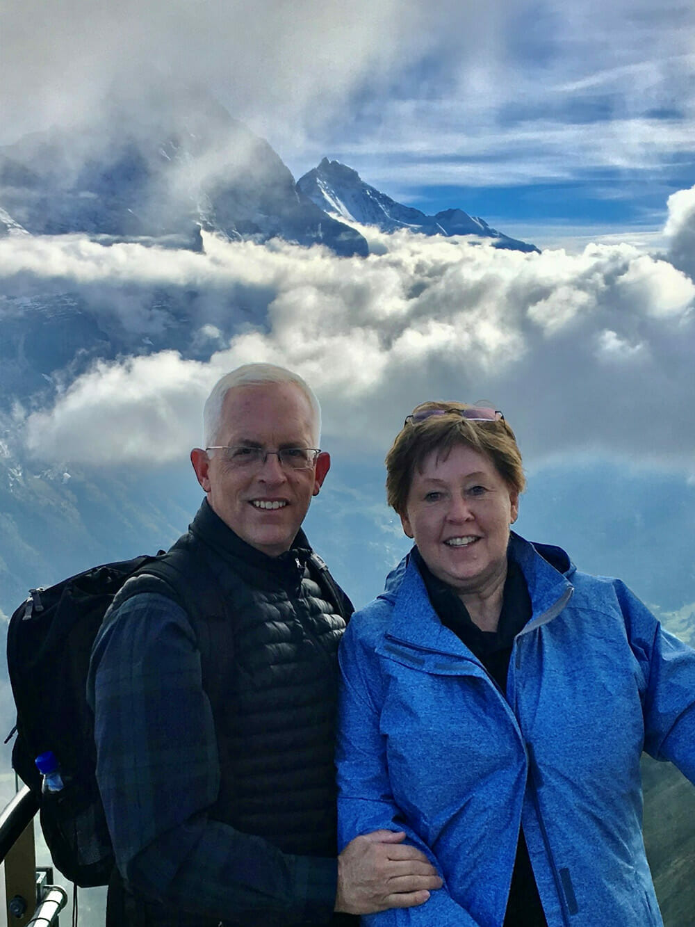 Jim Zuber in the mountains with his wife.